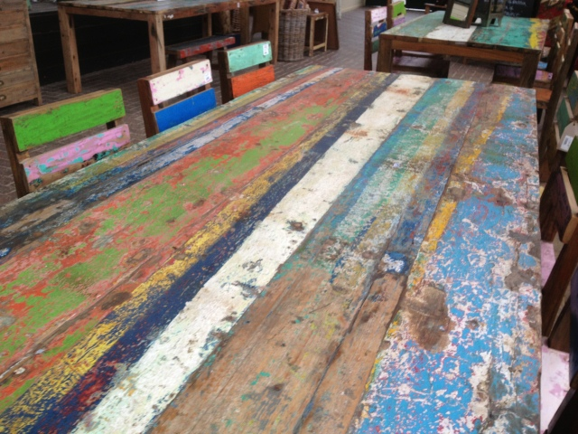 Table form reclaimed wooden boat sections - just love the textures on the paint.