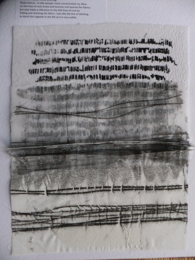 Sample 16 - Monoprint onto sheer and screenprint onto cotton. The sheer has vertical folds as a 3D reference to rock strata lines.