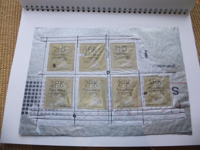 Sample 8 - Packaging sandwich - plastic postal bag, tissue paper, ironed bubble wrap and parcel stamps all machine stitched.