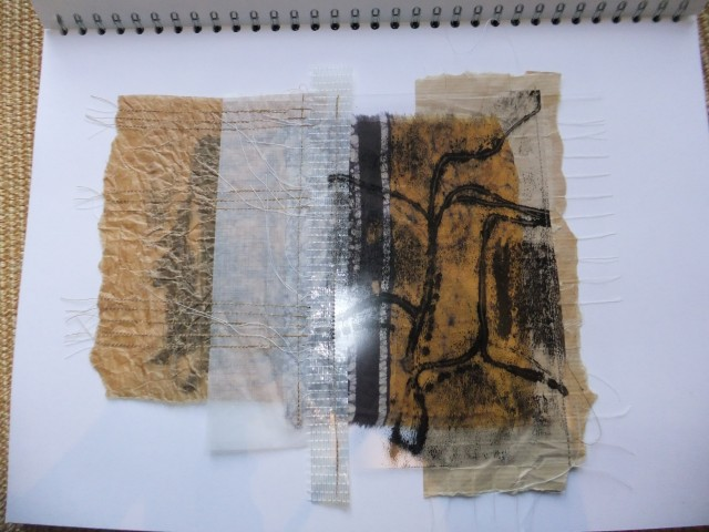 Sample 9 - reinforced brown envelope with cotton grid stitch, glassine paper, scrunched was paper, section pf plastic wrapping tape, section of batik skirt, old acetate image left over from other work all machine stitched.