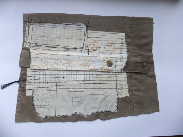 Sample 13 - Sleeve from unwanted shirt and paper collage of pages from sewing book showing sleeve, collar and cuff instructions,  all machine stitched.