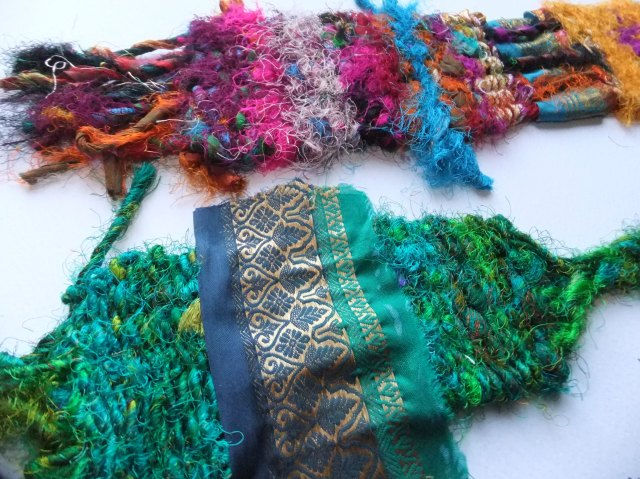 Sample 3 - Didn't work as I had wanted. I had made a drawing in my sketchbook (see above) where I had wanted a band of woven sari yarn and then something more loose at the bottom and these were some samples to see how it worked out. I realised I needed to weave it the other way, horizontally, to get a wide but short woven piece but I didn't have the equipment to do this. Probably not the required amount of sari yarn either.