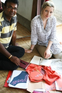 Designer Isabel Browton is discussing embroidery options with artisan maker for the Rita Dress.