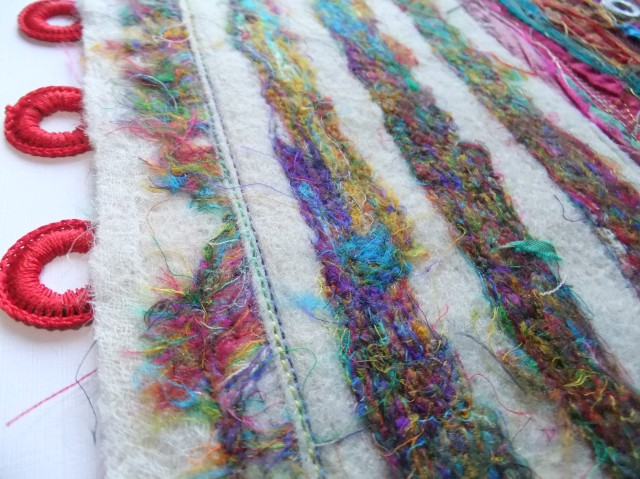 Sample 7 detail - showing the felted stripes and the fibre fringe on the left.