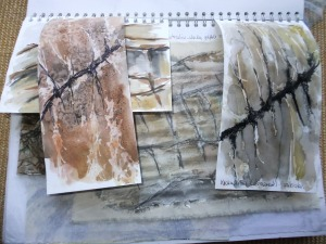 Rock lines and patterns - gesso on calico and pastels, masking fluid and watercolour. Different papers for interest.
