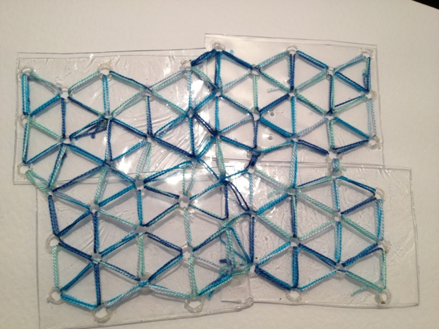 "Using Egyptian Faience glass bead amulet as inspiration for a stitch and ""glass"" fragmented response"
