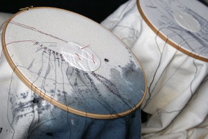 CAROLINE BARTLETT  - Stilled -  the use of embroidery hoops to contain the textile and the porcelain roundel with the original texttile impression (ref http://arttextstyle.com/2013/09/15/exhibition-news-cloth-memory-2-yorkshire-uk/)