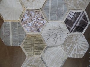Patchwork of paper and fabric to replicate the tessellation pattern in the stone carved ceiling.